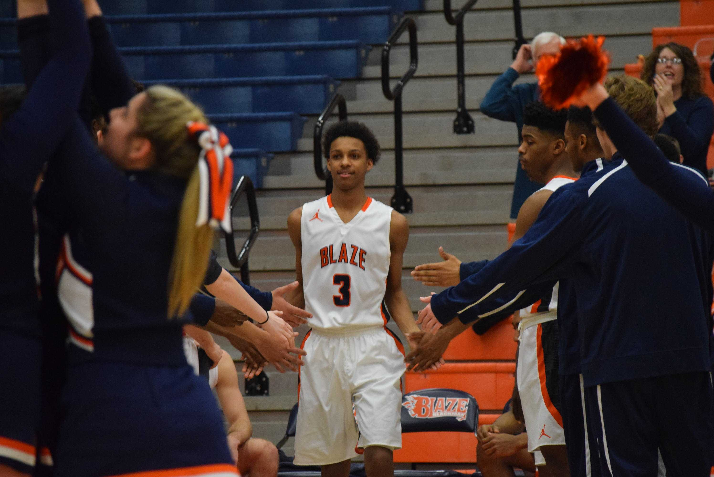 Photo by Jared Robinson Sims walks out for the starting lineups in the Region 4A quarterfinals