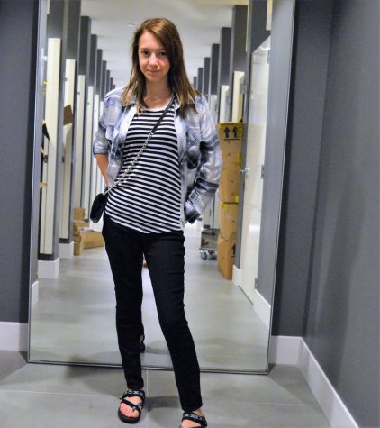 Photo by: Neko Collins Lauren Barina, 8th Grader at Stewarts Creek Middle School, wears a striped tank-top, a plaid jacket, skinny- cut jeans, and a chained black purse at Forever 21.