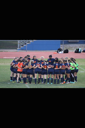 The Lady Blaze huddle up before their game against Lavergne