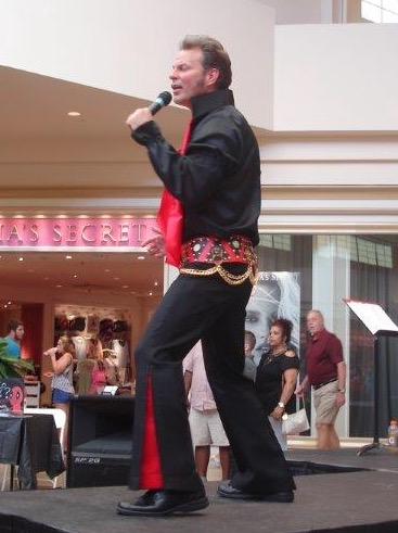 Here, Jason Whited is dressed as Elvis Presley performing for a crowd at Stones River Mall.