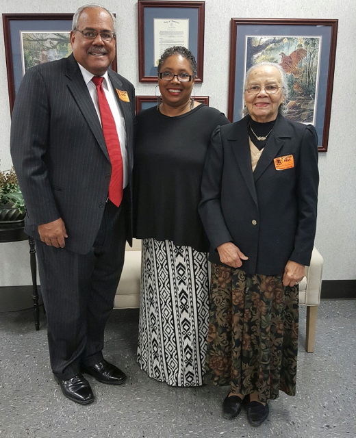 Caption: Criminal justice teacher and track coach, Pamela Recasner stands with black history speaker, Howard Gentry, and his mother.