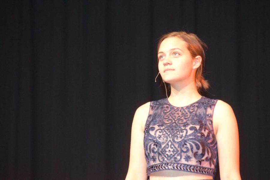 Kayla Zuck, senior, practices her performance.