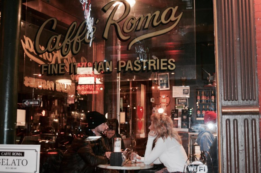 Day Two: After the museum, we went back to Little Italy to see it at night. We decided to stop by this little cafe. Here's a picture of my parents from an outside perspective.