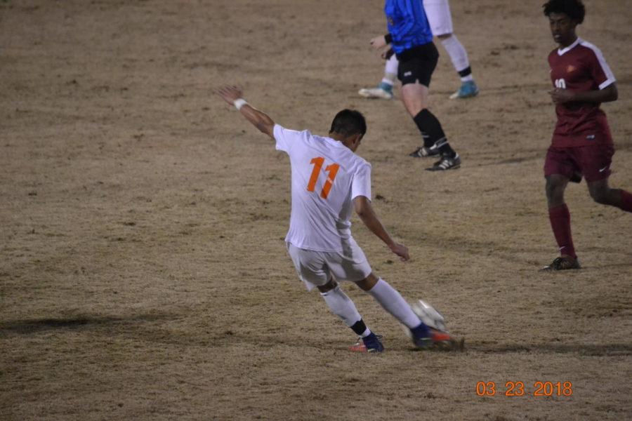Kobe Srisaroth strikes the ball across the field.