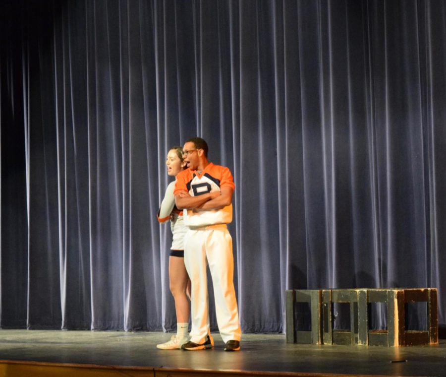Aubrey and Hope back to back during their skit.