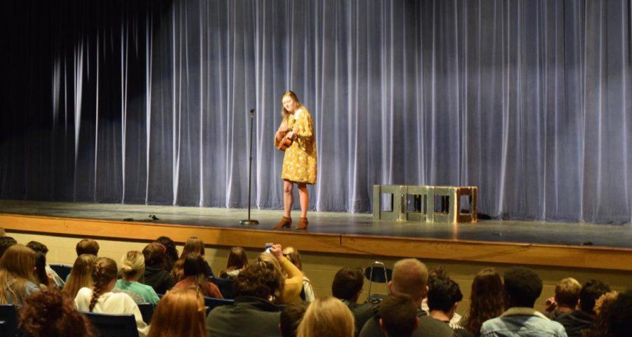Rachel Thweatt, senior, preforming her song acoustically with her ukulele.