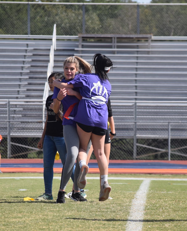 Kamryn+Huyck%2C+junior%2C+cheering+on+her+teammate+Hannah+Eakes%2C+junior.