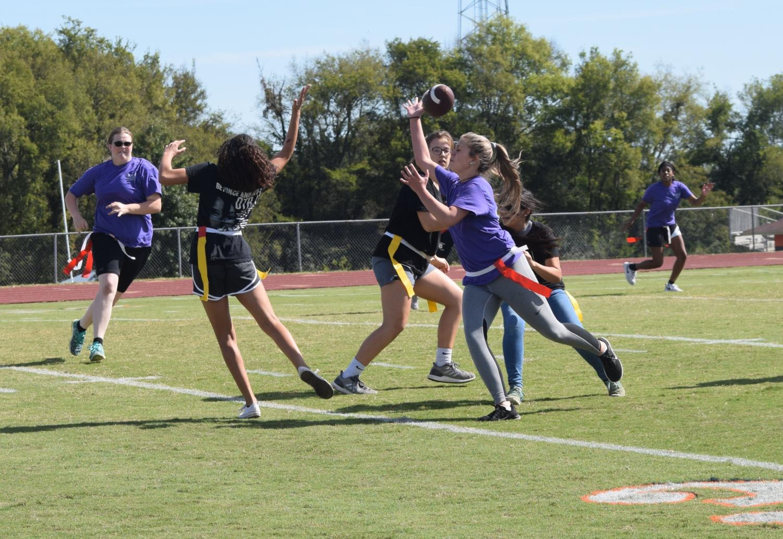 Hannah+Eakes%2C+junior%2C+and+freshman+fighting+over+the+ball.