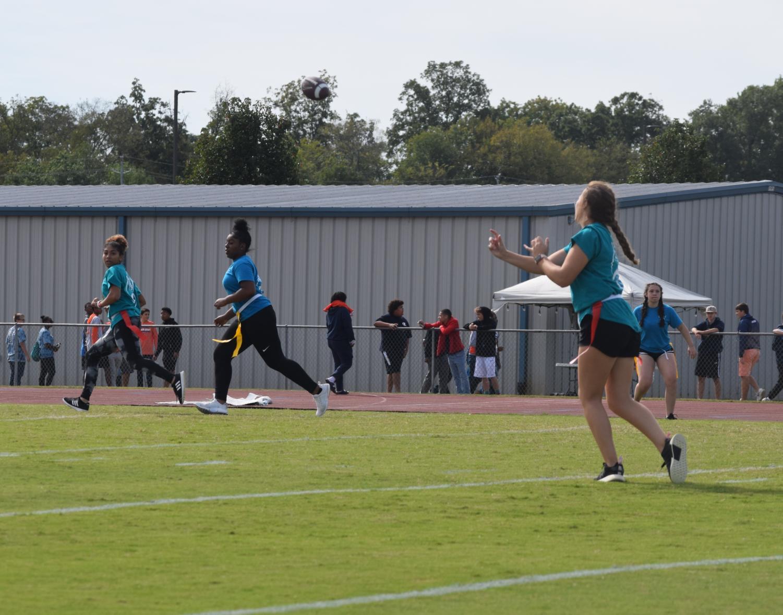 Caitlyn+Manus%2C+senior%2C+quarterback+making+a+great+throw+to+her+teammates.