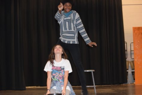 John Micheal Lyons (the narrator) dances around Olivia Sorrell (Cinderella) as she sings.