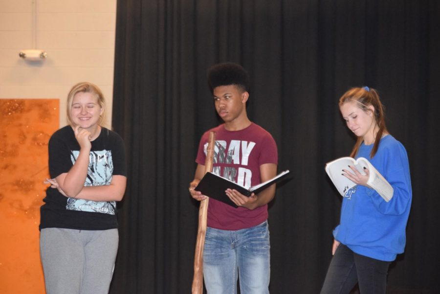 Erin Seifert(the Witch), Issac McCaulley(the Baker), and Sarah Oppman(the Baker's Wife) rehearse a scene where they are finding out they have to go into the woods.
