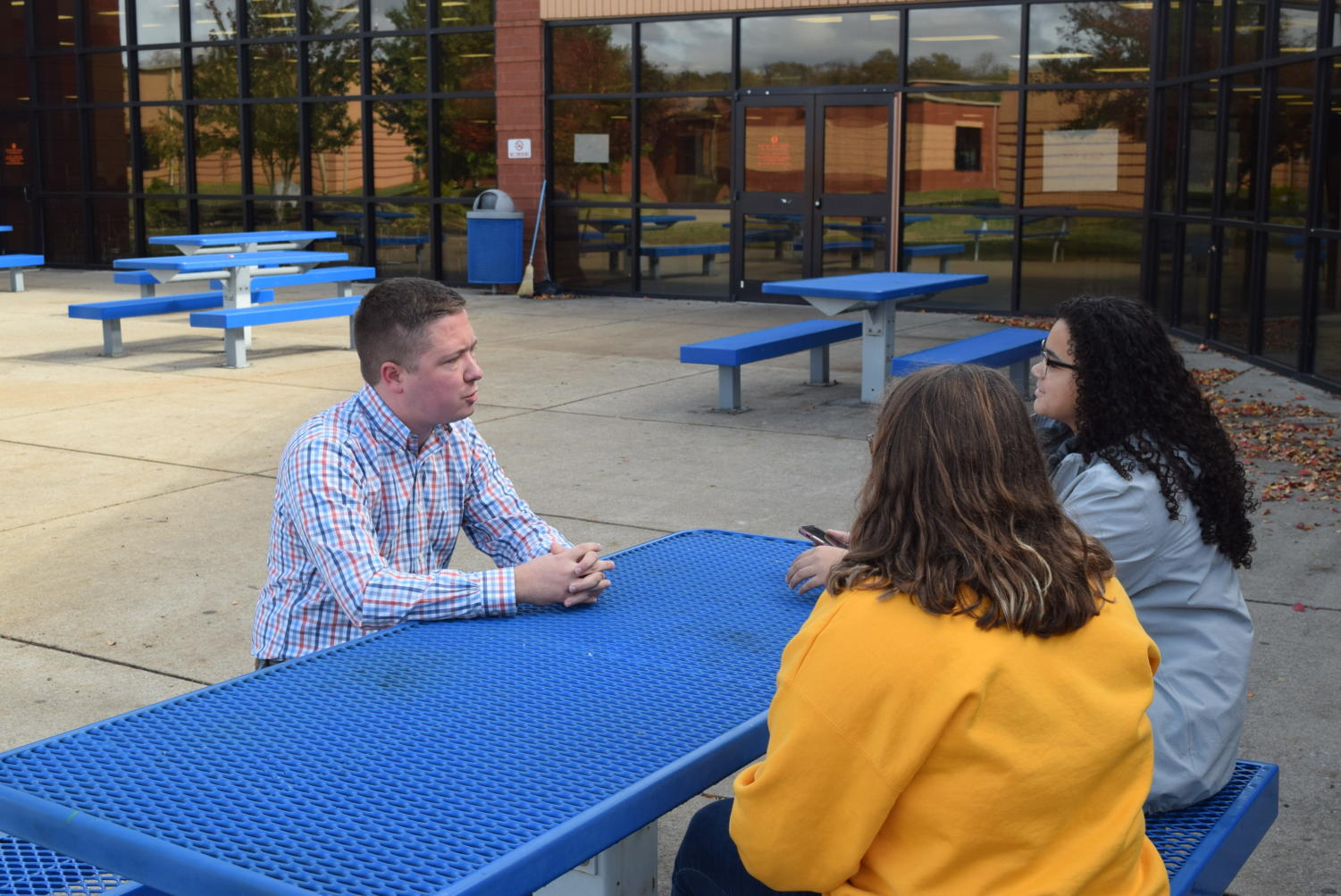 Matthew Hurts speak to the Blackman Voice staff in the courtyard.