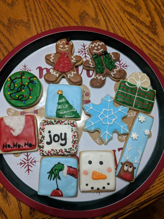 A beautiful spead of christmas cookies iced to perfection.