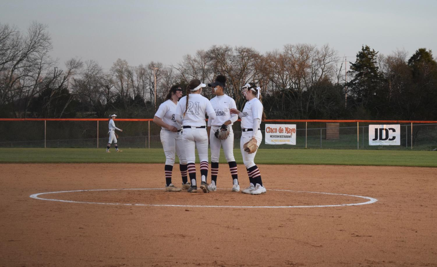 Lady+Blaze+infield+hyping+up+their+pitcher.