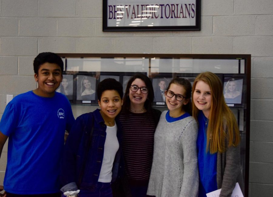 Some of the students at orientation in front of the BHS Valedictorians display.