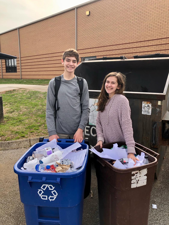 Daniel Koralewski, sophomore, and Elizabeth Nelson, sophomore, recycling for Key Club.