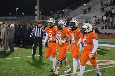 Blackman players head to mid-field for opening coin toss.