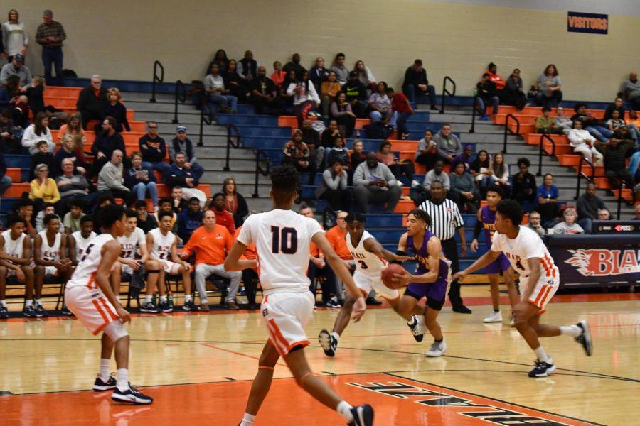 Basketball team on defense.