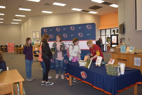 Students getting their book signed by Courtney Stevens.