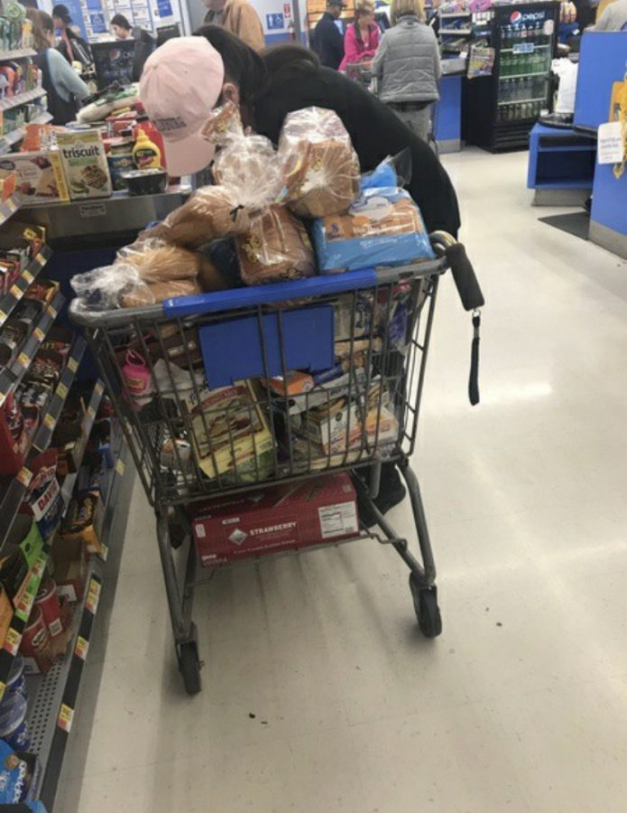 A woman stocking up on groceries for quarantine.
