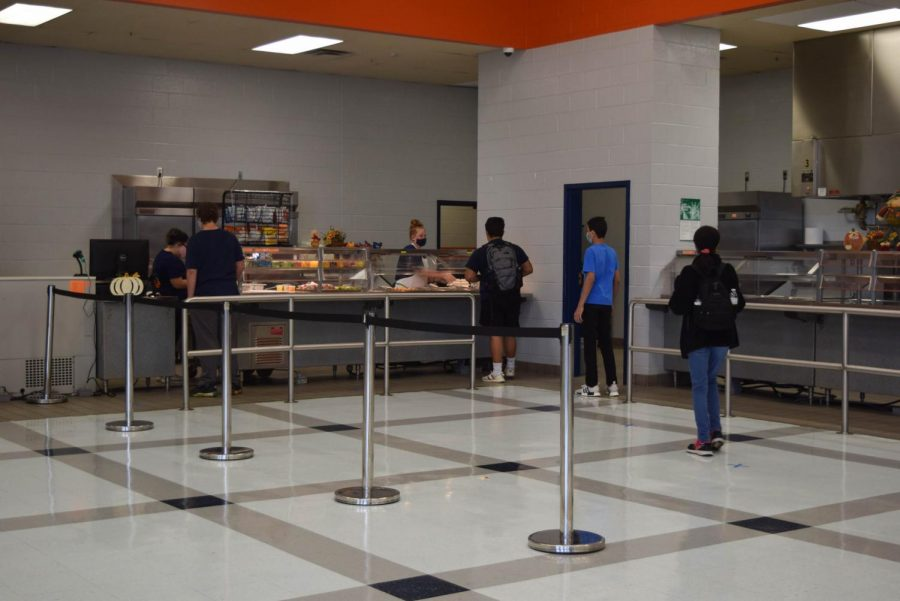 Students are socially distanced as they collect food from the cafeteria