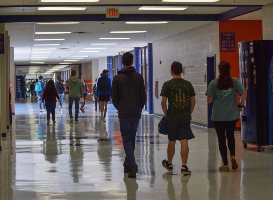 Students wear masks in the hallway during class changes