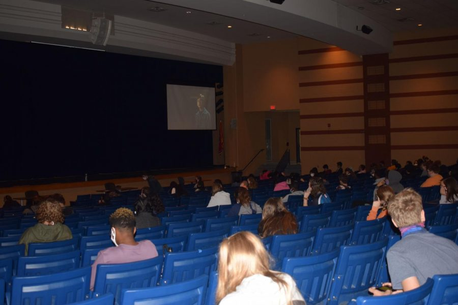 Students socially distance while watching movies in the auditorium.