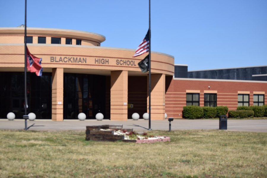 Flags outside of BHS at half-staff to honor lives lost by COVID-19