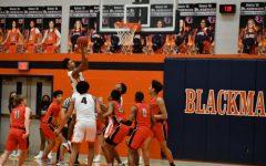 Blackman's Jabahri Mastin drives to the hoop in the Blaze's district semifinal game vs Stewarts Creek.
