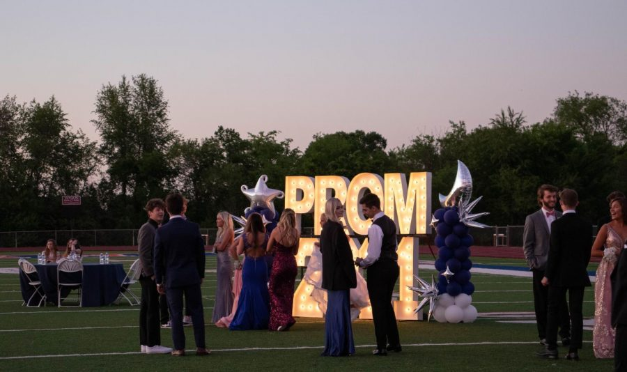 Attendants chatted around the PROM 2021 backdrop.