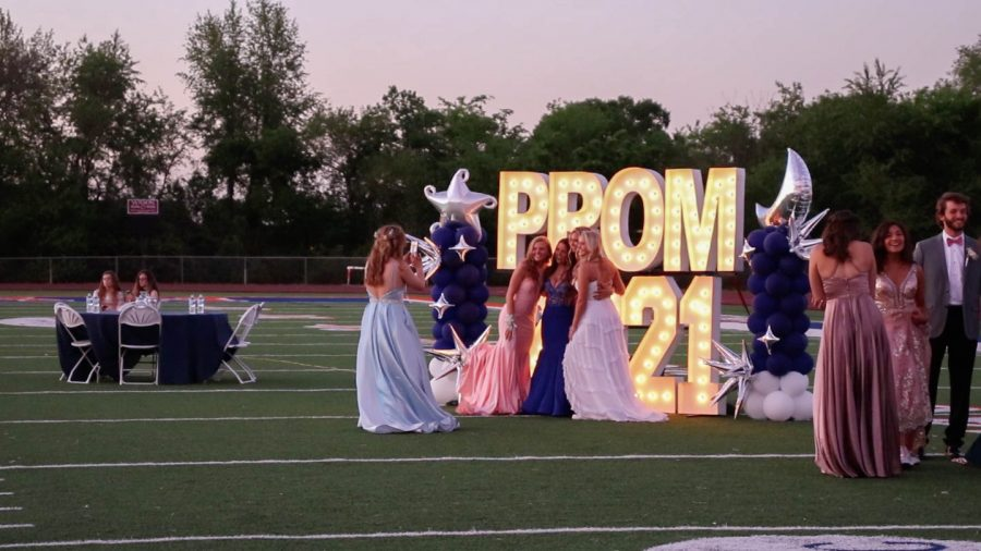 Attendants posed for photographs in front of the PROM 2021 backdrop.