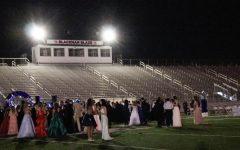 Stadium lights illuminated the field.