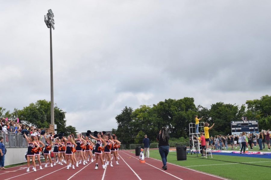 The Blackman High school cheerleaders perform during the first pep rally on game day.