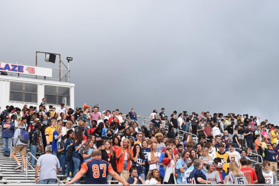 The Blackman High School student section is excited during the first pep rally on game day.