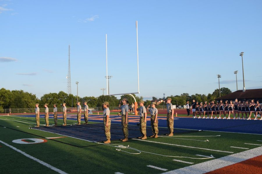 Rotc saluting during the national anthem before the first home football game.