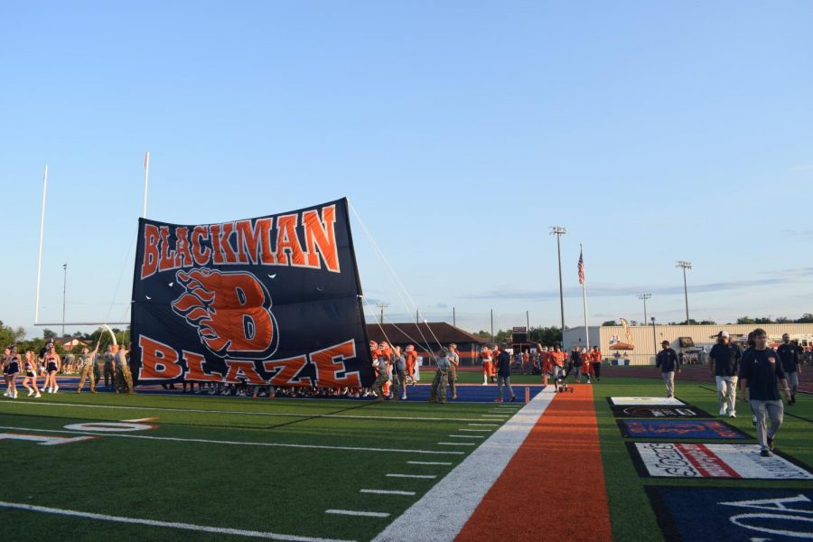 The Blackman Blaze Football team right before the run through the flag to get on the field.