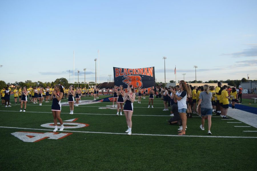 The Blackman Blaze cheerleaders right before the Blaze football team run through the flag to enter the field.