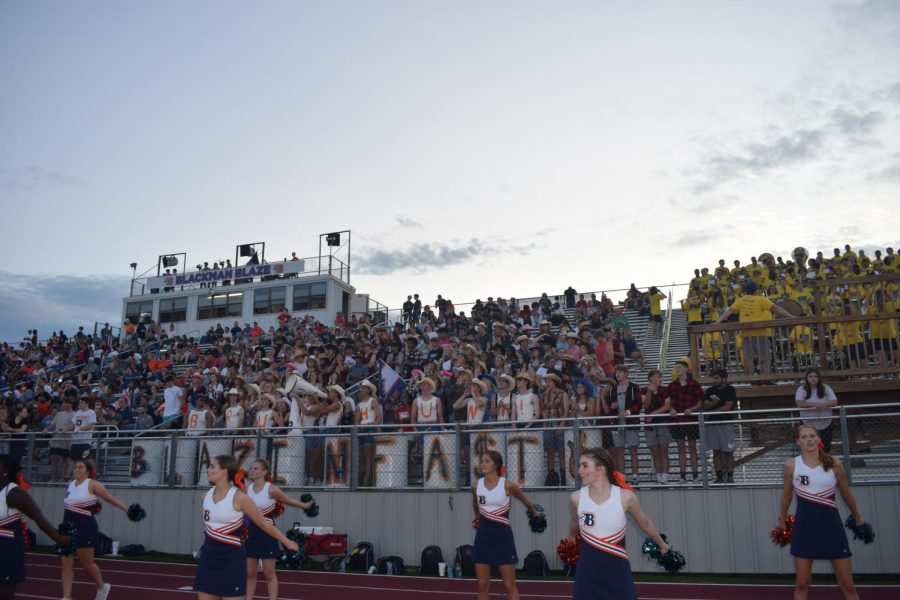 A picture of the dance team and student section at the start of the first home football game.