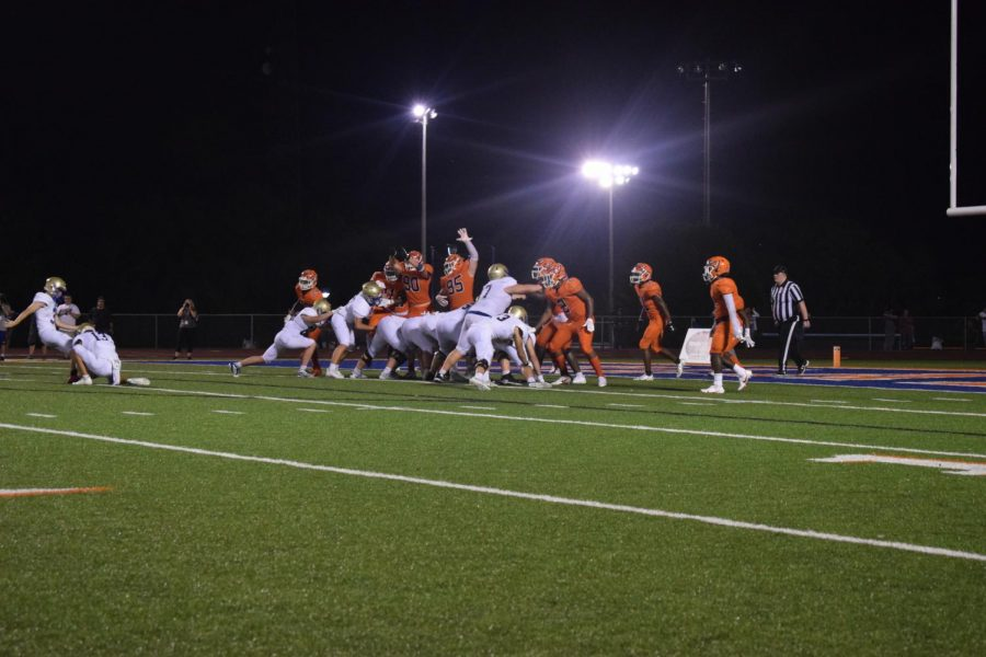 The blaze football team making an attempt to block the Brentwood field goal kick.