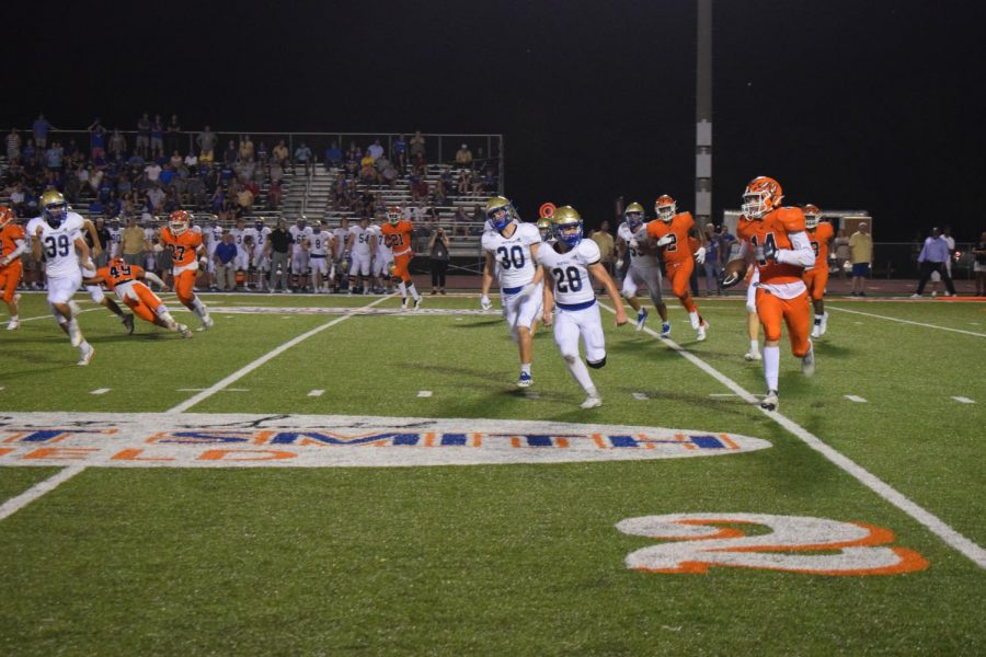 Number 14 catching the ball during the fourth quarter at the first home football game against Brentwood.