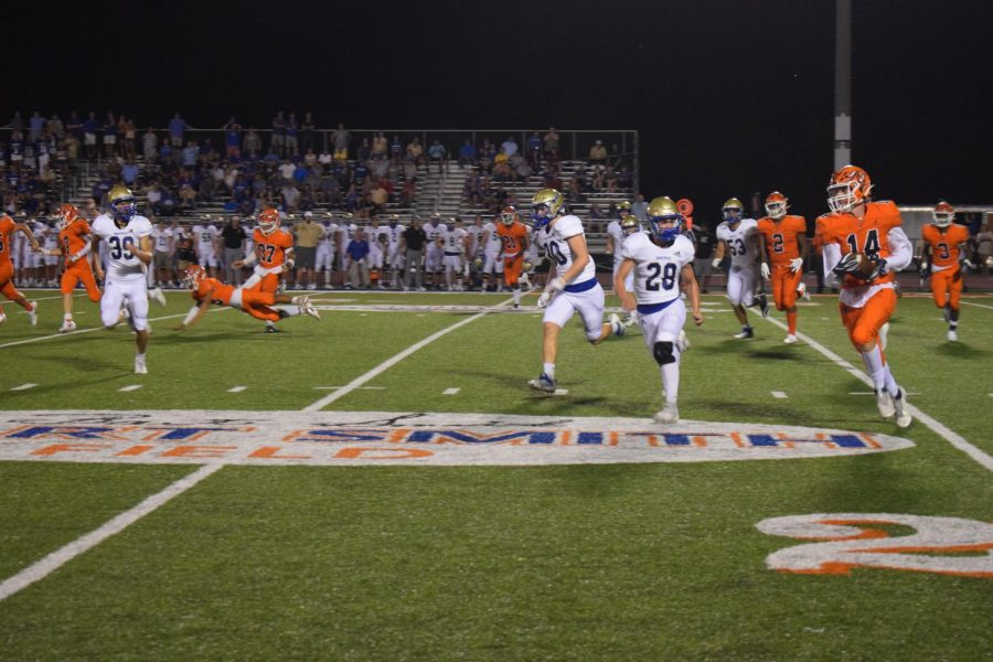 Taken during the first home football game against Brentwood. Number 14 running the ball past 20 yard line to get a touch down.