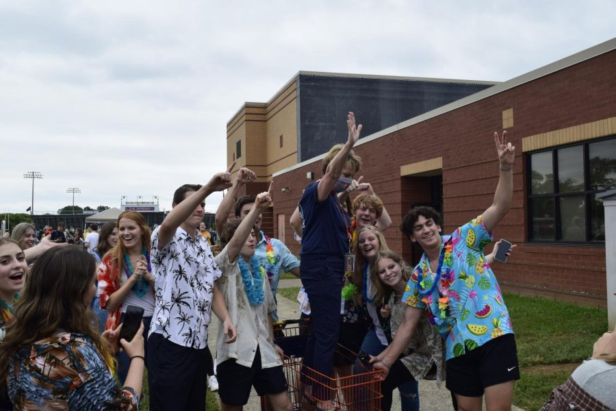 Dr. Justus get into the Student Section shopping cart during Blaze Bash.