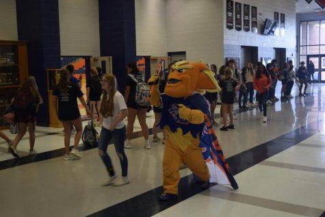 Dante joins the Band, Cheer Team, and Student Section as they walk through the halls during the Homecoming 2021 Pep Rally.