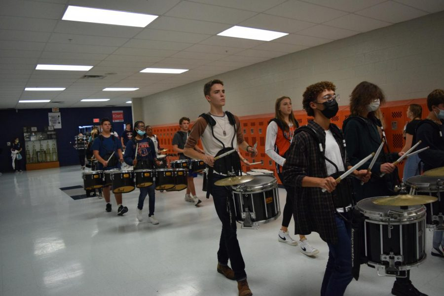 Blaze Bands Drumline walks through the halls during the Homecoming 2021 Pep Rally.