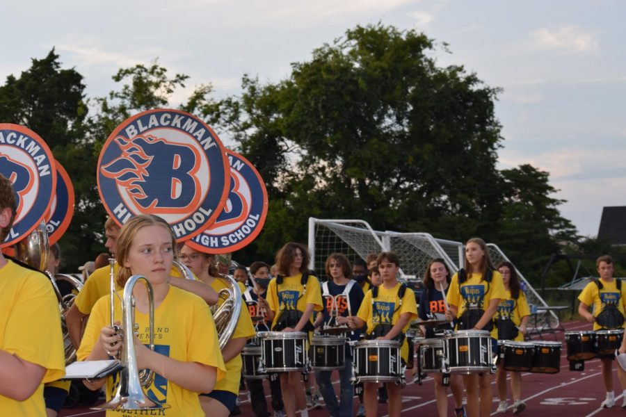 The Blackman Blaze Marching Band walks before the game.