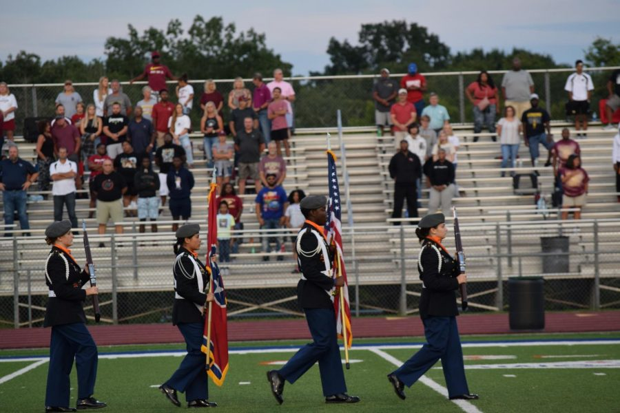 JROTC carries flags onto the field for the National Anthem.