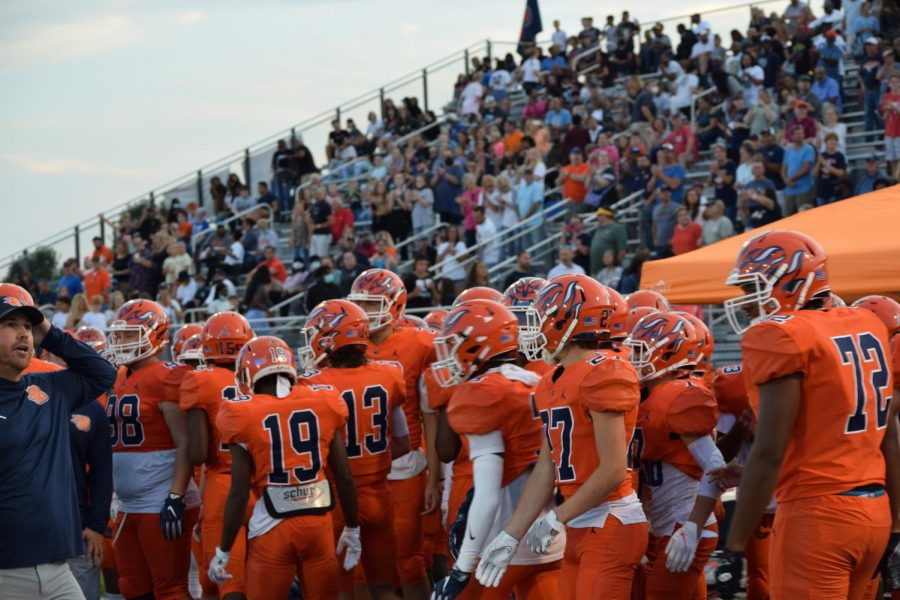 The Blackman Football team congregates on the sidelines just before kickoff vs. Riverdale.