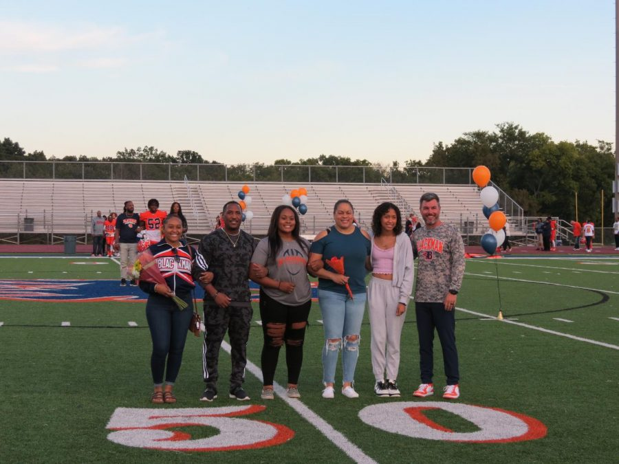 Manager Jordan Smith is honored during the Senior Night ceremony before the football game.