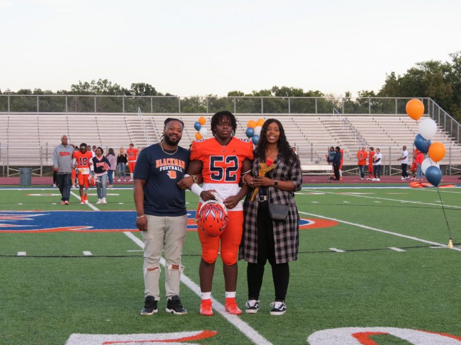 Jaylen Brown is honored during the Senior Night ceremony before the football game.