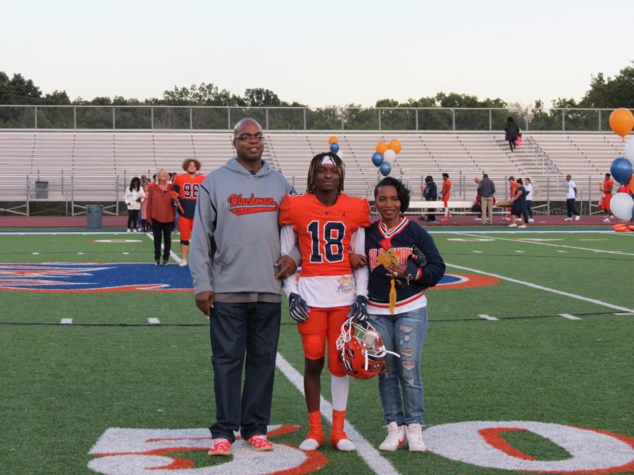 Jamar Carson is honored during the Senior Night ceremony before the football game.